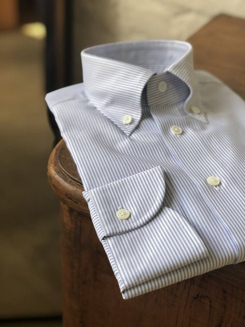 WHITE button down shirt with blue stipes