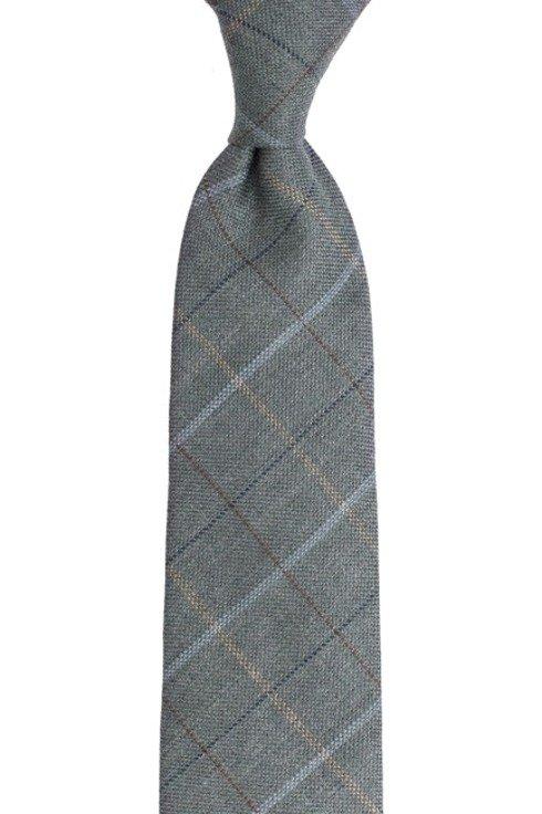 Lniano- wełniany krawat bez podszewki. Szeroka szałwiowa krata.
